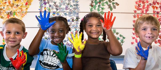 Kids with painted fingers -- ASO home page