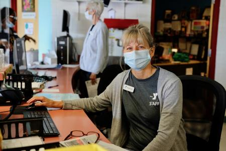 Front desk lady with mask
